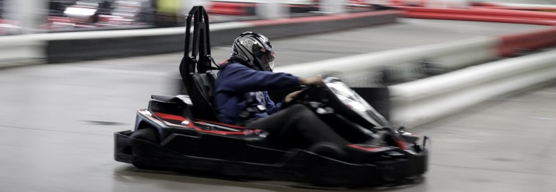 a black kart on a track